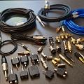 Vadi, kabeļi, audiovadi, spraudņi, konektori, štekeri, ligzdas, pārejas, adapteri, komponentes, savienojumi